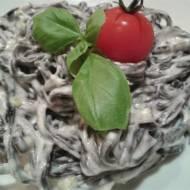 Tagliatelle al nero di sepia w sosie porowym z trzema serami