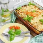 Naleśniki z kurczakiem i marchewką, zapiekane z sosem pomidorowym i żółtym serem